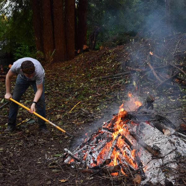 2020-raking-burn-pile-together